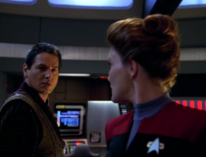 Janeway and Chakotay share a fraught look on the bridge. They totally look like they want to make out.